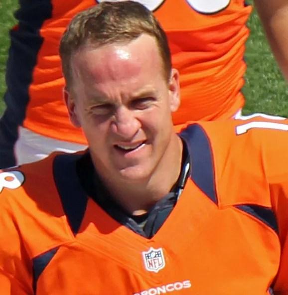 Headshot of Peyton Manning in orange Broncos uniform