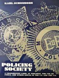 "Blue and white book cover of ""Policing Society"" wh deals with bullying ."