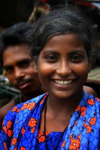"Bangladeshi woman with a smile that defies ""lookism.""."