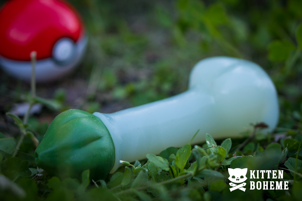 Geeky Sex Toys Pokemoan Bulby Silicone Dildo Laying in the Grass with a Pokeball in the Backgroud