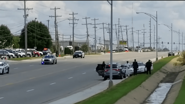 Vehicle Appears from Woods as Trump Motorcade Drives By