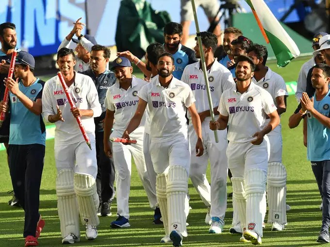 Indian players circling the field after victory.