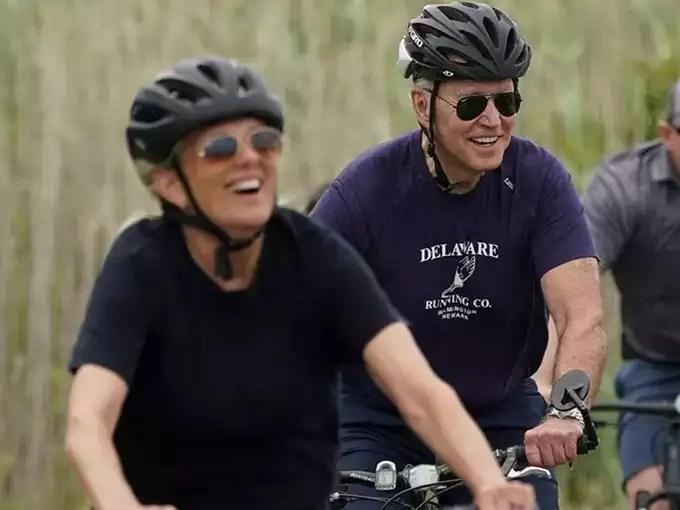 US President Biden and first lady Jill Biden go biking at Cape Henlopen State Park in Rehoboth, Delaware.
