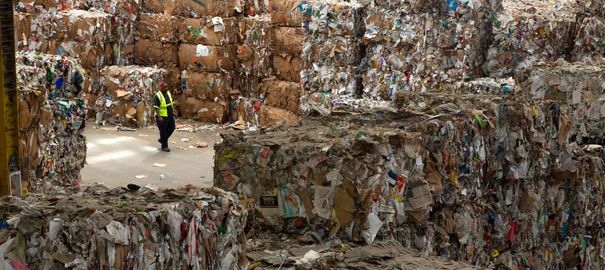 "A worker walking  inside the Recology plant in San francisco on March 23, 2105.  Recology is  an integrated resource recovery company that collects and processes municipal solid waste and reclaim useful materials that would have otherwise been buried in a landfill. It promotes recycling, composting, and other waste-reduction programs to minimize the amount of materials sent to landfills.  Recology is the largest organics compost facility operator by volume in the United States. The name Recology is a combination of the words ""recycle"" and ""ecology?. (Frederic Neema/Polaris) ///    *** Local Caption *** 05118419  report 3328"