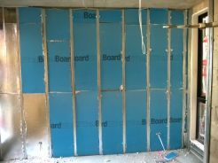 Insulation being installed- cool in winter, warm in summer