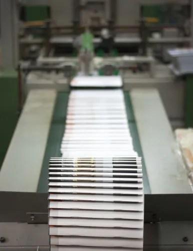 A printing press manufacturing books