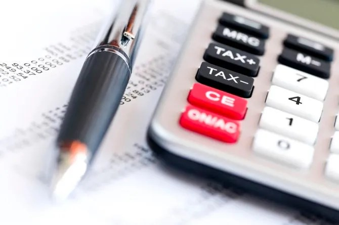 Calculating tax with pen and calculator