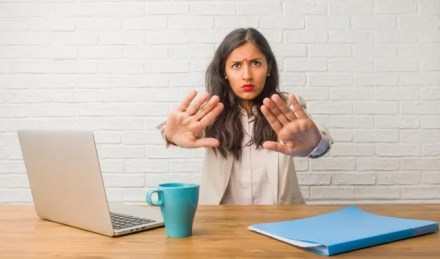 Woman at the office making a stop gesture with hands