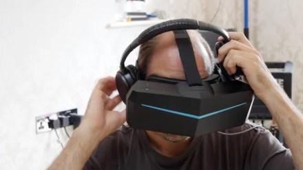 Putting on headphones and adjusting the Pimax 5K plus