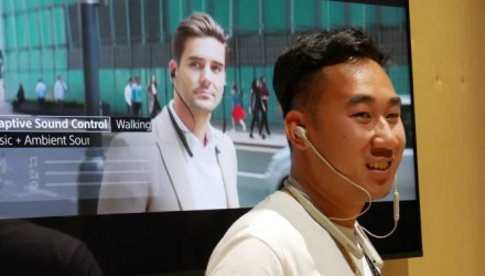 Sonly employee wearing the Sony WI-1000XM2 headphones at IFA 2019.