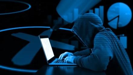 A hacker manipulating votes
