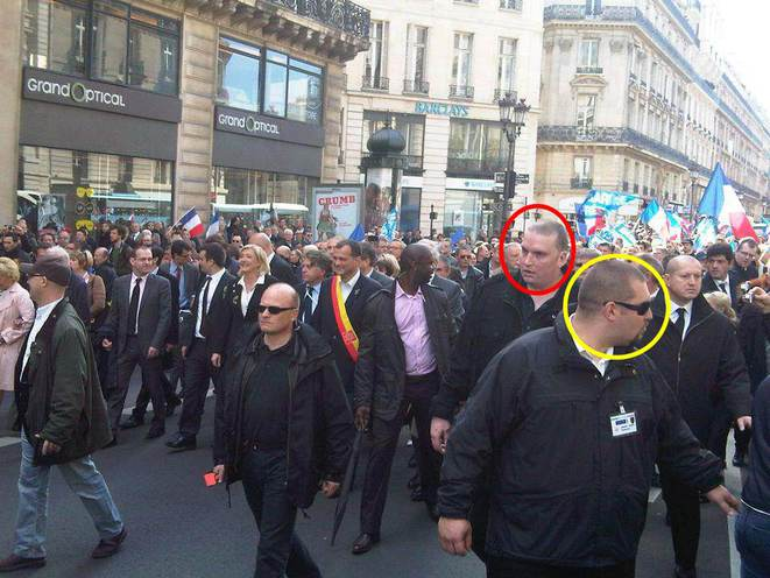 Olivier Vivien (cercle rouge) et Daniel Mack (cercle jaune) assurent la sécurité du défilé du 1er Mai du FN, en 2012.