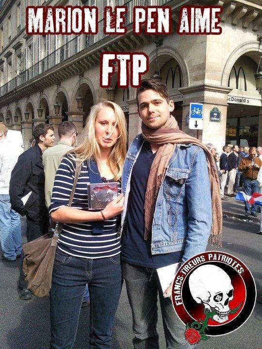 Marion Maréchal-Le Pen lors d'un défilé du 1er-Mai du FN, rue de Rivoli, à Paris, avec le rappeur d'extrême droite Fasc.