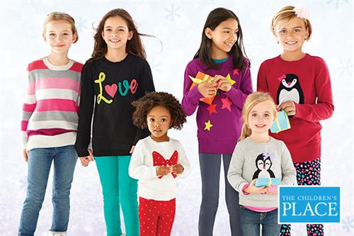 Six kids smiling in sweaters from The Children's Place