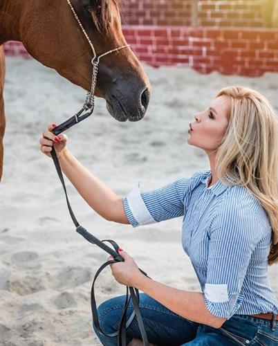 Animal lover and social media influencer Georgina Wiggins blowing a kiss to her horse, Rocket Boy