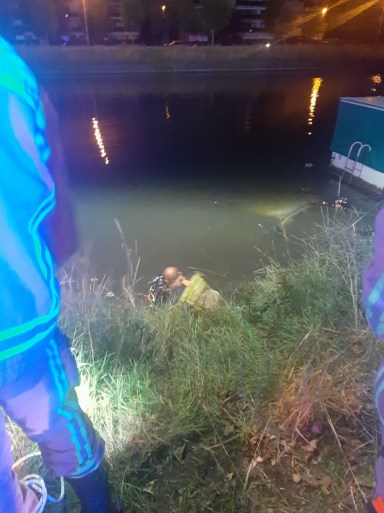 Car ends up in water after police chase, two occupants unharmed