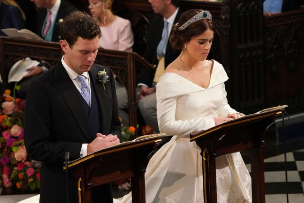 Britain's Princess Eugenie of York (R) and Jack Brooksbank (L) kneel at the alter during their wedding ceremony at St George's Chapel, Windsor Castle, in Windsor, on October 12, 2018. (Photo by Jonathan Brady / POOL / AFP) (Photo credit should read JONATHAN BRADY/AFP/Getty Images)
