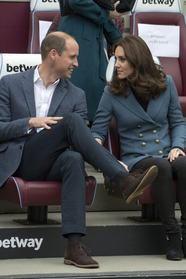 Britain's Prince William, Duke of Cambridge and Britain's Catherine, Duchess of Cambridge share a light moment during their visit to attend the graduation ceremony of more than 150 Coach Core apprentices at West Ham United's London Stadium, in east London on October 18, 2017. / AFP PHOTO / POOL AND AFP PHOTO / Arthur Edwards (Photo credit should read ARTHUR EDWARDS/AFP/Getty Images)
