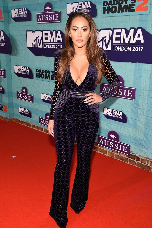 Sophie Kasaei wearing a black dress