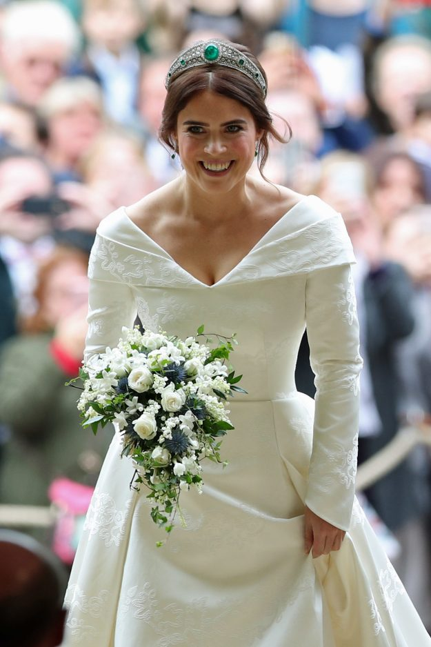 Britain's Princess Eugenie of York (walks up the aisle during her wedding ceremony to Jack Brooksbank at St George's Chapel, Windsor Castle, in Windsor, on October 12, 2018. (Photo by Yui Mok / POOL / AFP) (Photo credit should read YUI MOK/AFP/Getty Images)