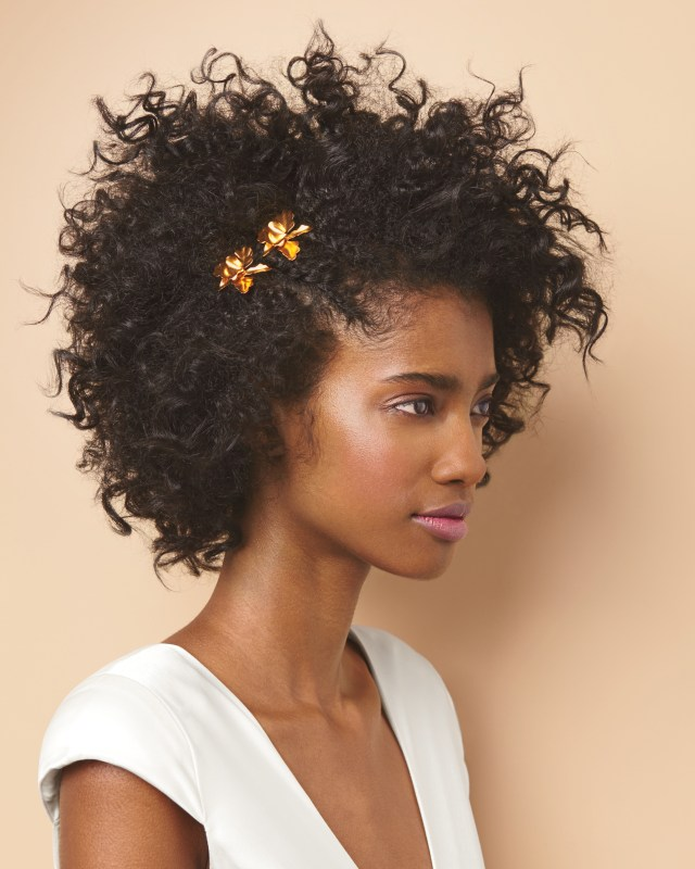 14 pinterest-worthy wedding hairstyles for curly hair