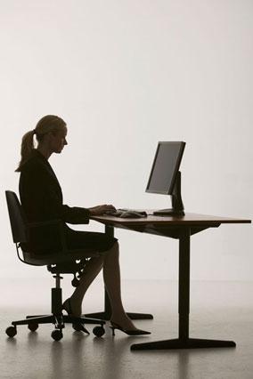 Image result for sitting at desk