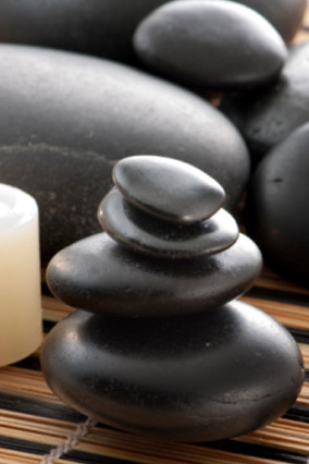 smooth stones and candle