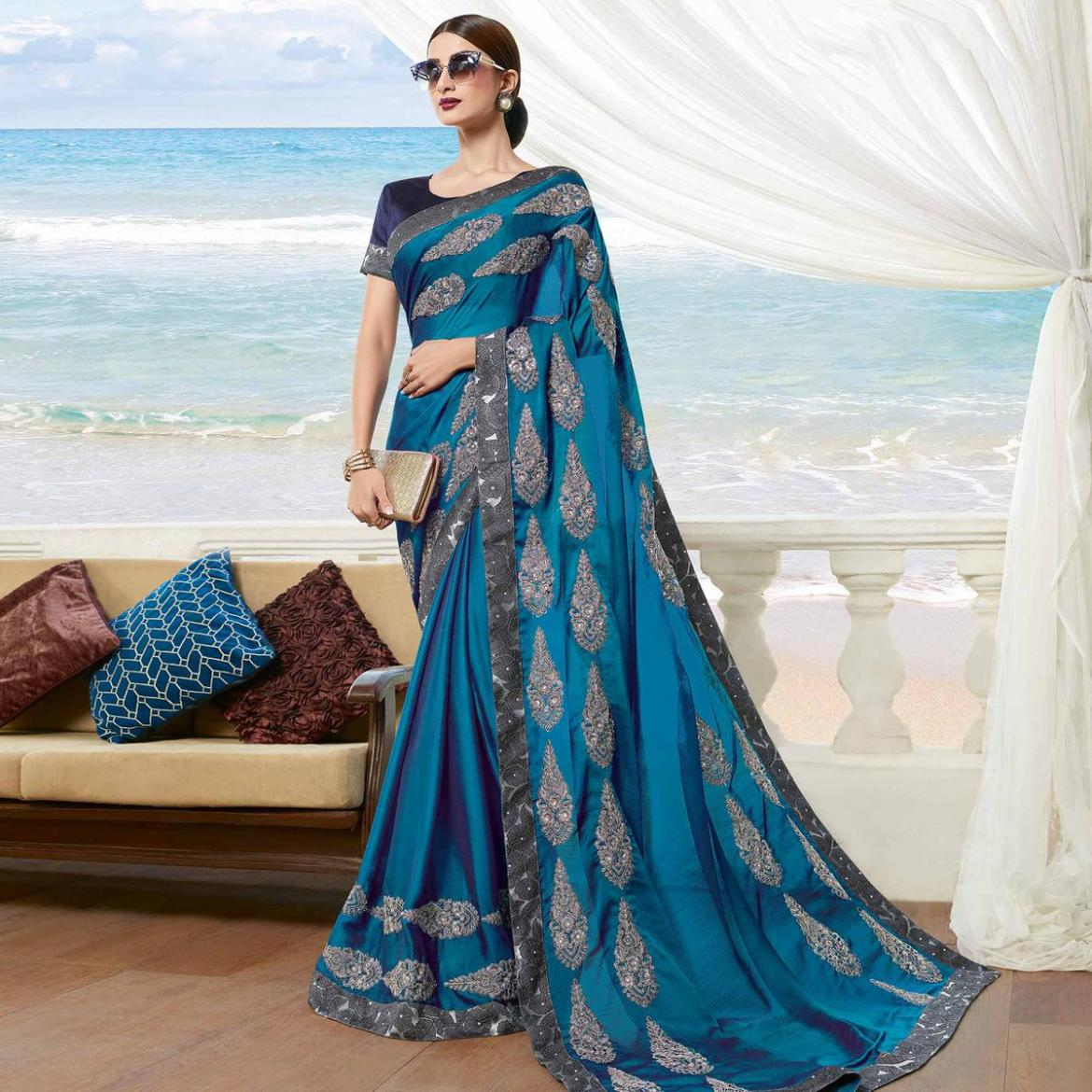 Excellent Teal Blue Colored Partywear Embroidered Georgette Saree