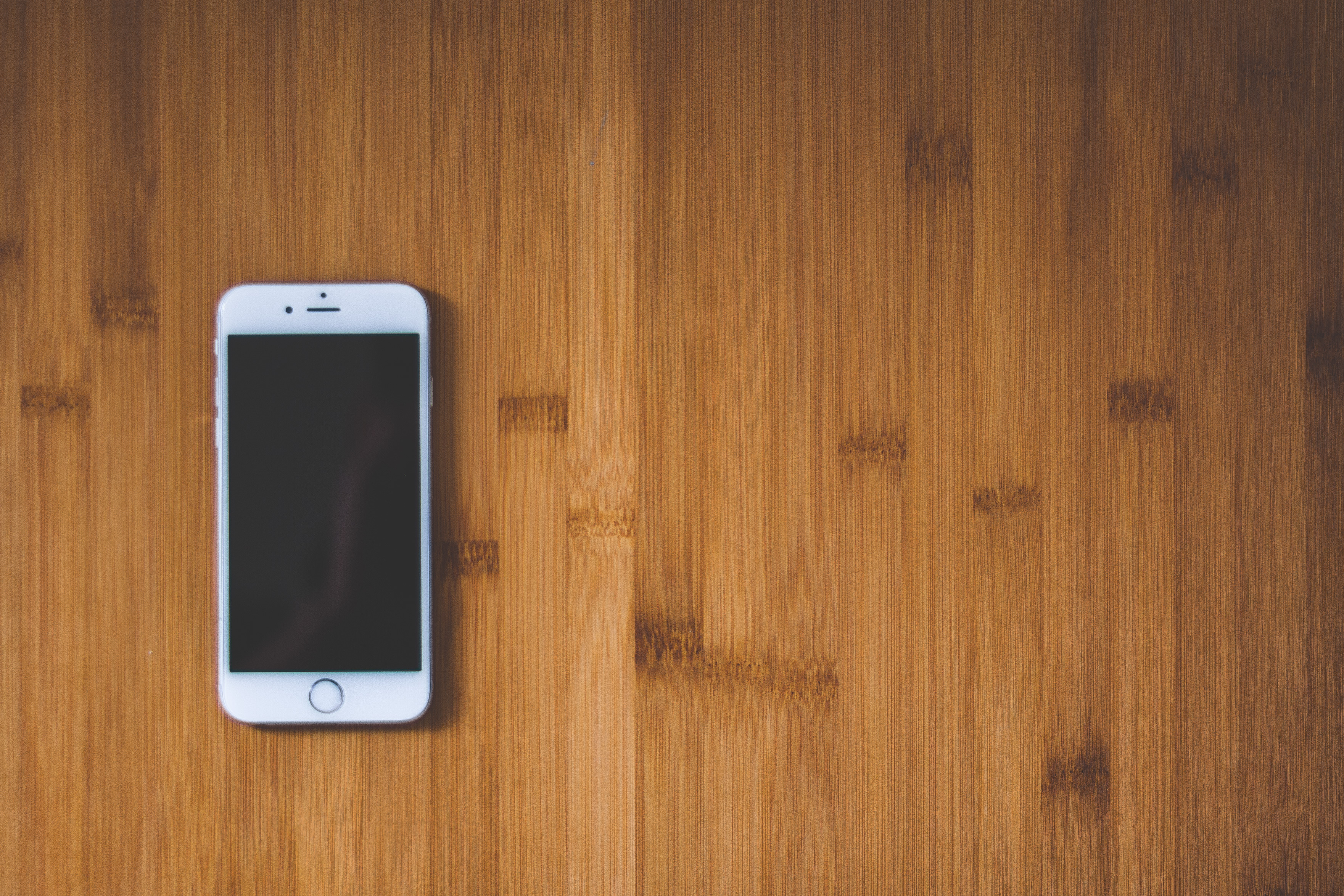 Silver Iphone 6 On Brown Wooden Surface Free Stock Photo
