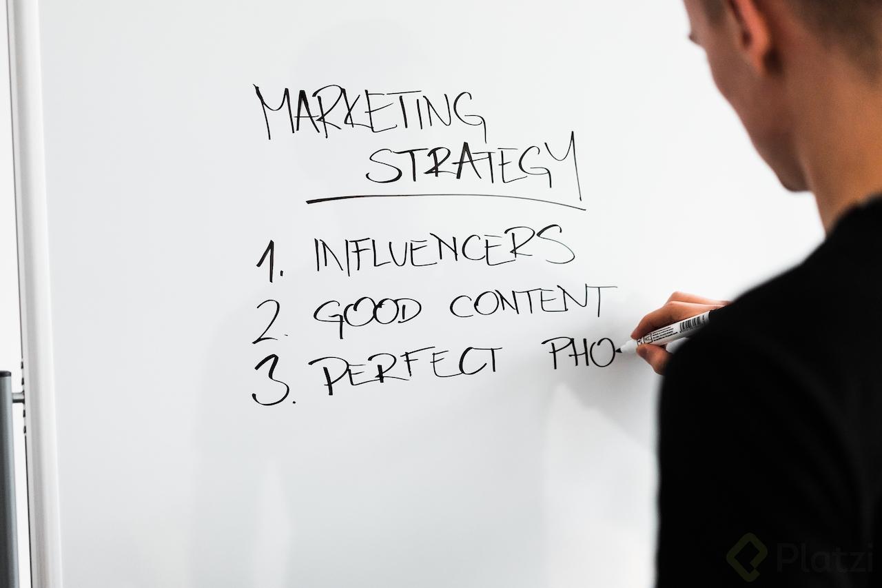 marketing-expert-writing-new-marketing-strategy-on-whiteboard-picjumbo-com.jpg
