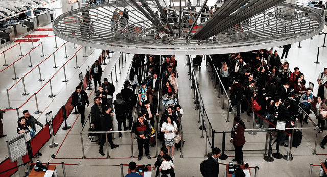 People wait in a security line at John F. Kennedy Airport in New York City.