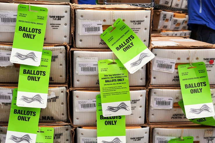 Boxes in the first batch of 111,000 mail-in ballots are tagged and ready to ship from the Douglas County Election Commission's office to the post office, in Omaha, Neb., Monday, Sept. 28, 2020.