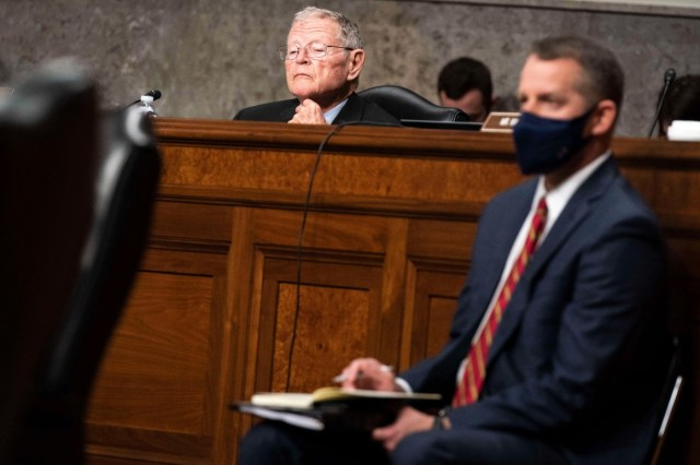 Sen. Jim Inhofe listens during a hearing in review of the Defense Authorization Request for fiscal year 2022 and the Future Years Defense Program on March 25, 2021, in Washington.