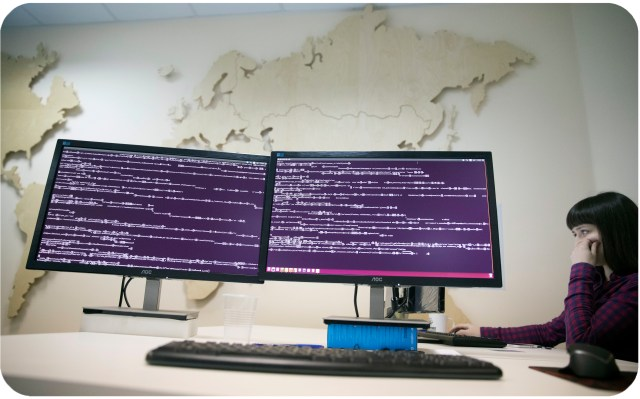 A computer code is seen on displays in the office of Global Cyber Security Company Group-IB in Moscow, Russia