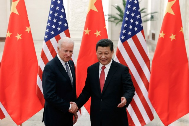 Chinese President Xi Jinping, right, shakes hands with then U.S. Vice President Joe Biden.