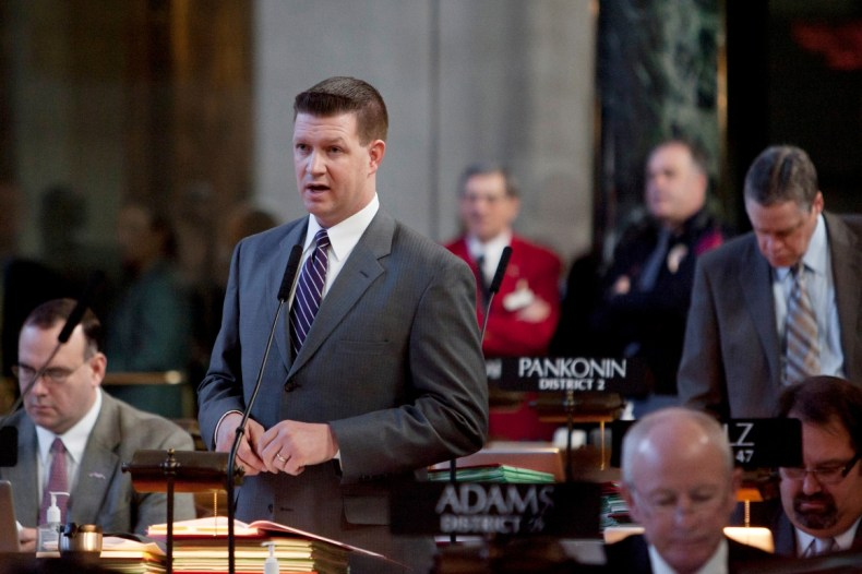 Sen. Beau McCoy of Omaha speaks in Lincoln, Neb., Tuesday, March 1, 2011, on his bill (LB22).