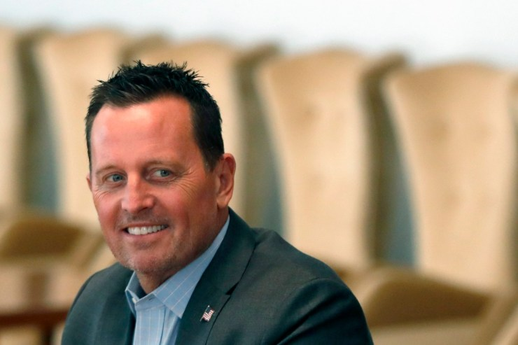 Richard Grenell smiles as he takes part in a meeting.