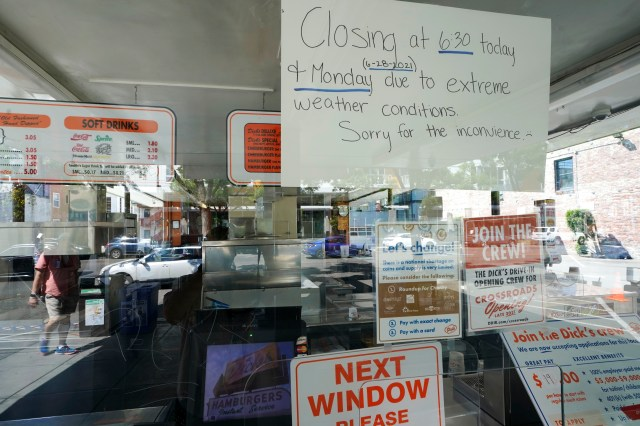 A sign in the window of the Dick's Drive-In in Seattle's Capitol Hill neighborhood is shown on June 28, 2021.