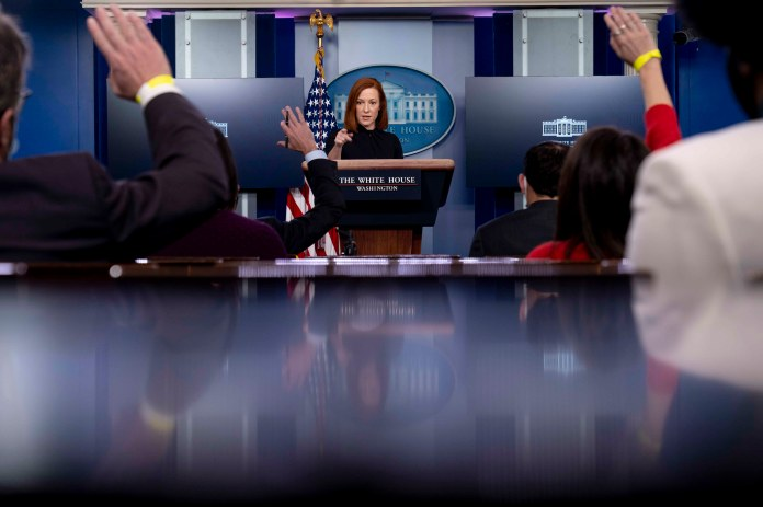 White House press secretary Jen Psaki takes a question from a reporter during a press briefing.