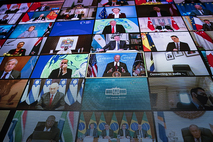 A grid of video screens of world leaders is pictured. | Getty Images