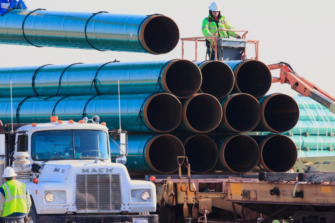 Workers unload pipes for the Dakota Access Pipeline.