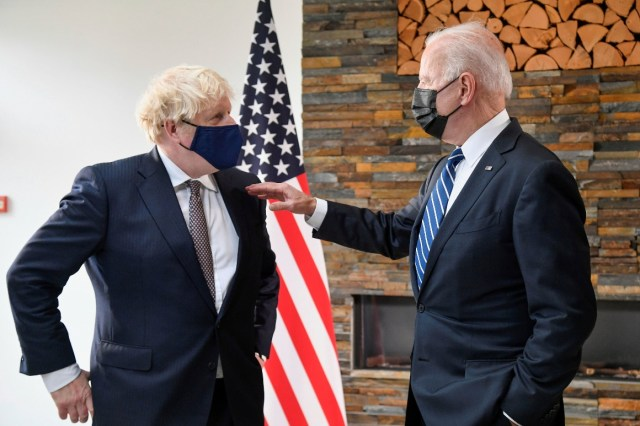 President Joe Biden, right, talks with Britain's Prime Minister Boris Johnson, during their meeting ahead of the G-7 summit.