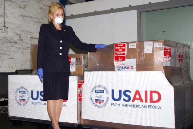 U.S. Ambassador to South Africa Lana Marks posing with ventilators donated by the U.S. Government. | Leon Kgoedi, United States Embassy South Africa via AP