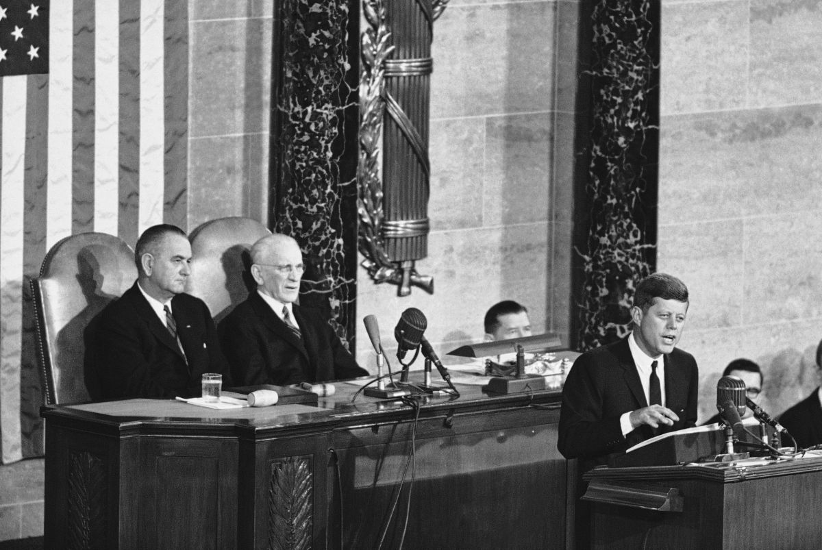 Seated behind President John F. Kennedy as he delivers his State of the Union address in 1962 are Vice President Lyndon Johnson and House Speaker John McCormack.