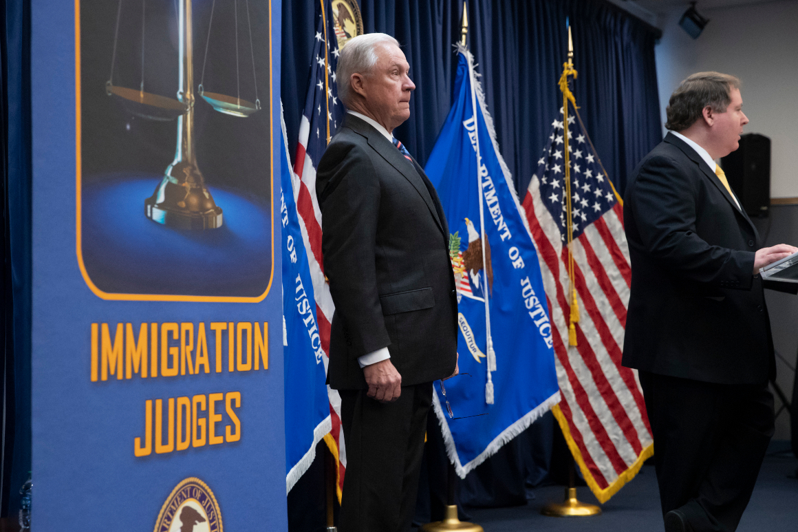 Jeff Sessions is introduced by James McHenry before outlining Trump administration policies to new immigration judges.