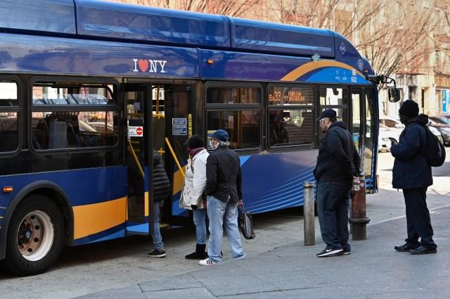People boarding MTA bus