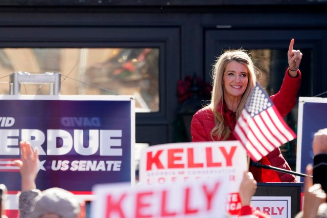Sen. Kelly Loeffler gestures as she speaks during a campaign rally.