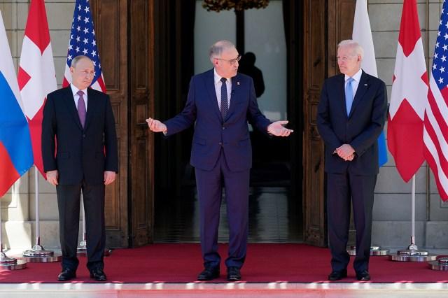 Swiss President Guy Parmelin, center, greets President Joe Biden, right, and Russian President Vladimir Putin.