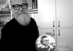 AA Bronson holding a plate depicting a photo of the most important…