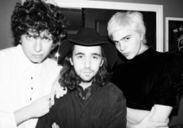 Nick Kivlen, Jacob Faber and Julia Cumming of Sunflower Bean backstage at...